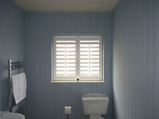 Waterproof shutters in blue bathroom